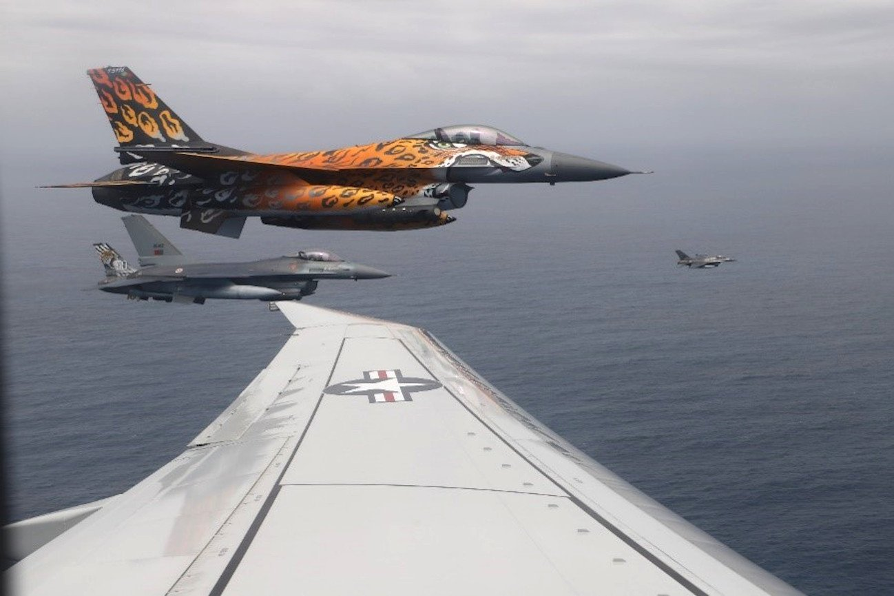 F-16s in formation with VP-40 Poseidon [US Navy/VP-40]