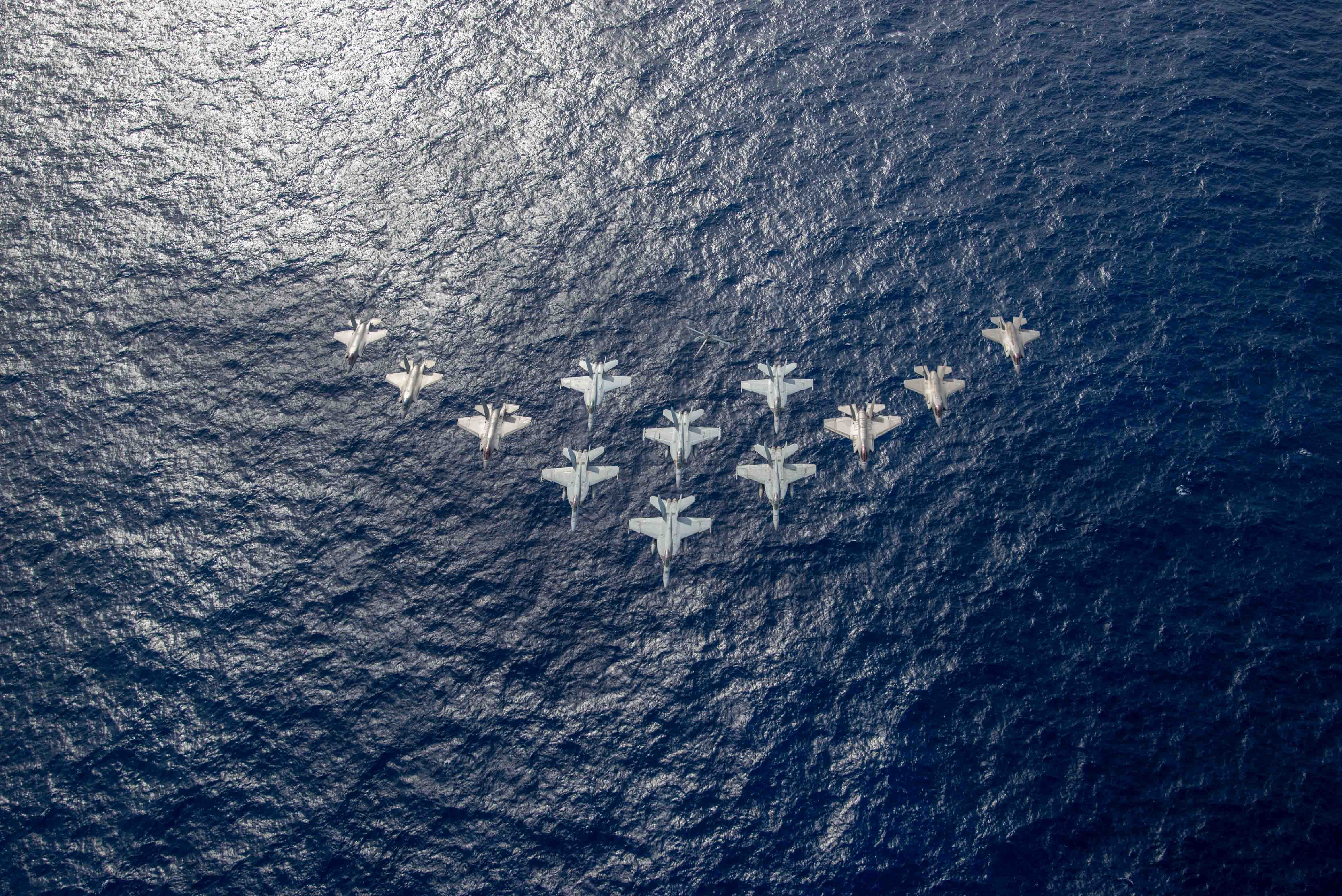 US Navy F/A-18E/Fs, F-35Cs and RAF/USMC F-35Bs flyover in Indo-Pacific 03-10-21 [US Navy]