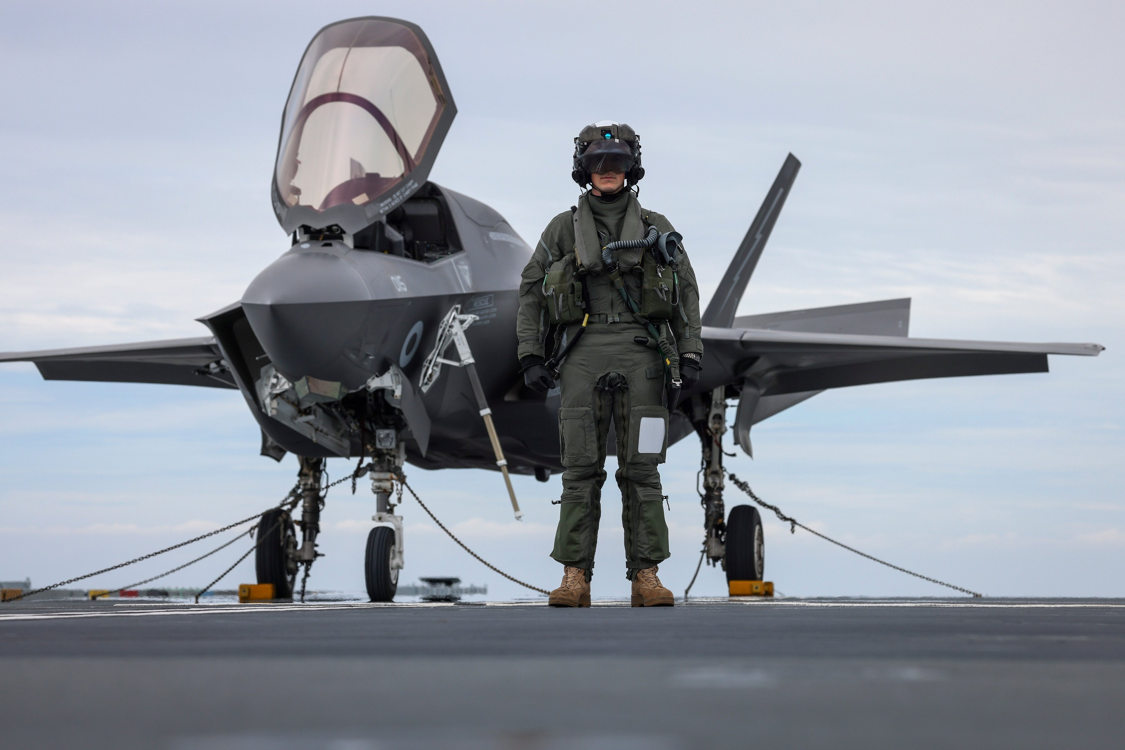 Sqn Ldr Will poses with F-35B on HMS PWLS 07-06-21 [MOD Crown Copyright/Leading Photographer Finn Hutchins]