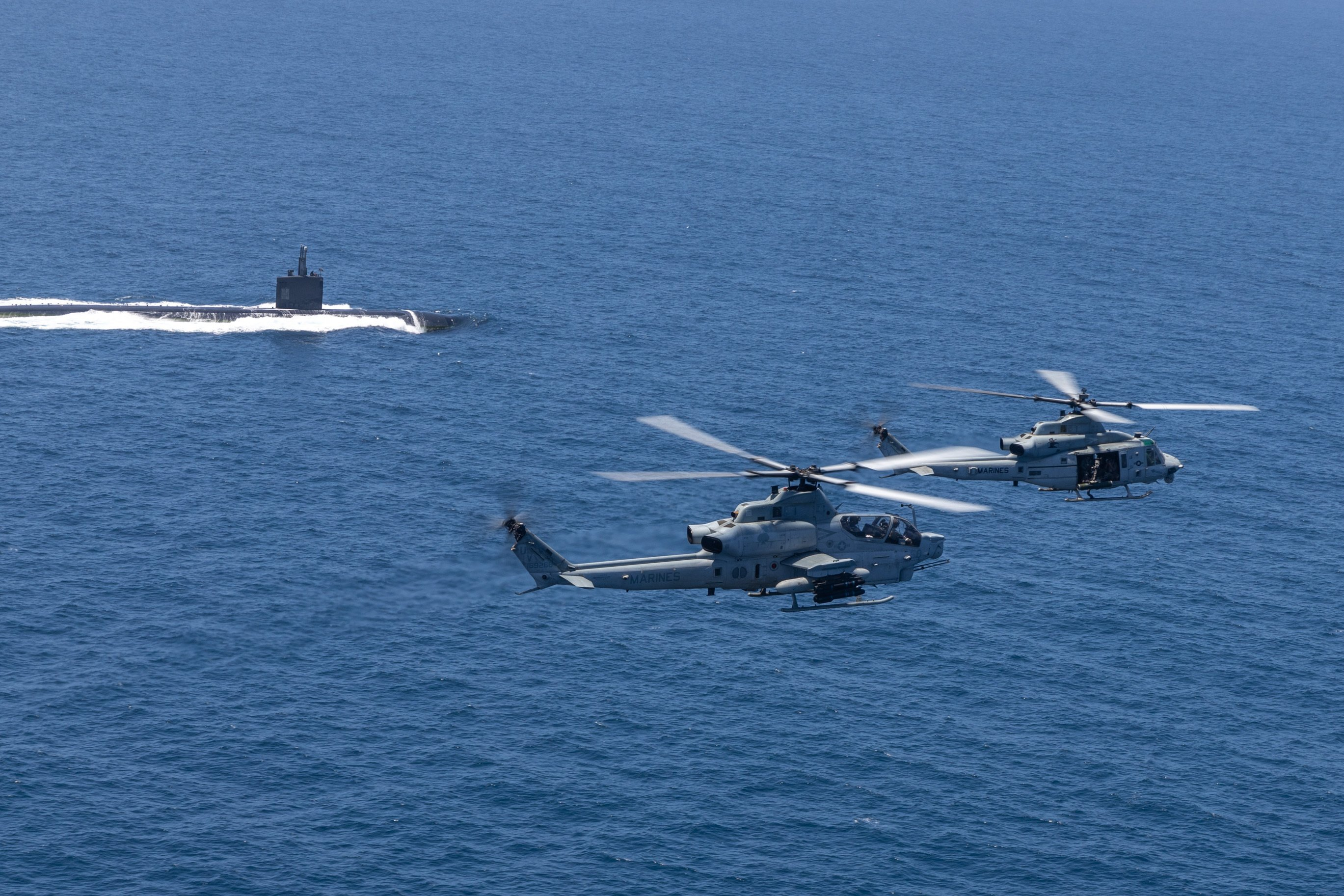 USMC HMLA-267 AH-1Z UH-1Y over USN sub in Pacific during Ex Summer Fury 20-07-21 [USMC/Lance Cpl Isaac Velasco]