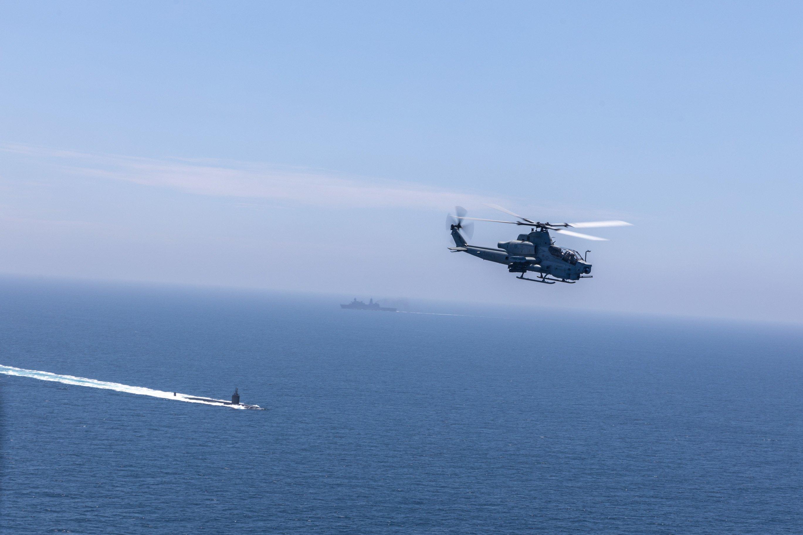 USMC HMLA-267 AH-1Z over USN sub in Pacific during Ex Summer Fury 20-07-21 [USMC/Lance Cpl Isaac Velasco]