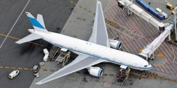 A Boeing 777 is being serviced at a MARS gate