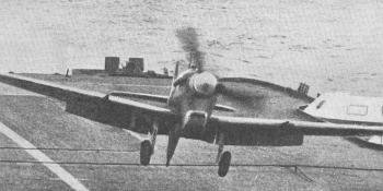 FORMIDABLE FIGHTER . – A Supermarine Seafire I, with arrestor hook extended, landing on the deck of H.M.S. Formidable during the operations at Salerno. The ships reported to have taken part in this action were the 23,000-ton carriers Illustrious and Formidable, covered by the Nelson and Rodney, and the escort carriers Attacker, Battler, Hunter, Stalker, and Unicorn, covered by light cruisers and destroyers.