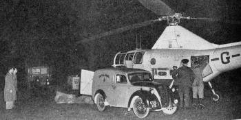 """NOCTURNAL ACTIVITY. – When the helicopter returns to Peterborough some of the mail is taken to the railway station and some to the post office for local distribution. A small quantity of mail is carried in the rear compartment, shown open in this photograph. All """"Aeroplane"""" photographs"""