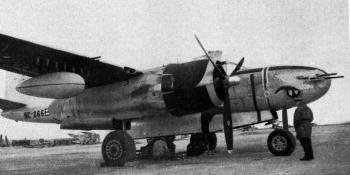 """A good comparison with the B-26C, this B-26 has the """"attack"""" nose, with eight 12.7 mm. machine-guns. In addition to its internal bomb load, this aircraft has the standard under-wing Napalm bomb. The wing guns and zero-length rocket mounts are also shown. All """"Aeroplane"""" photographs"""