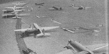 U.S.A.F. Skytrains at Tempelhof airport unloading supplies from the Western Zone.