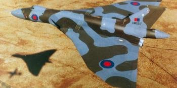 6 Epitomising the type's low-level role, the last Vulcan built, B2 XM657, formates with a cameraship for a photo sortie. This aircraft was conversely the first to receive, in 1979, the new wrap-around camouflage. CROWN COPYRIGHT