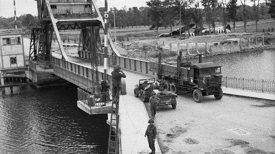 Army trucks crossing Bénouville Bridge over the Caen Canal on D-Day
