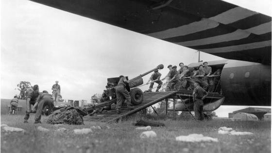 Soldiers dragging a canon in a Horsa aircraft in preparation for D-Day